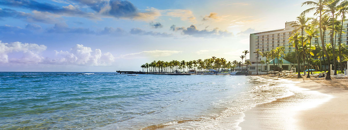 Stay 4 nights or more at the Caribe Hilton and enjoy a night on us